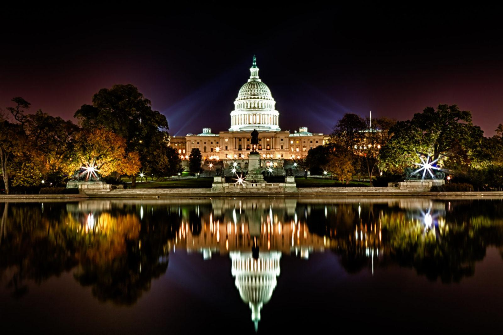 US Capitol Building and reflecting poll at night scaled - ავიაბილეთები ვაშინგტონი