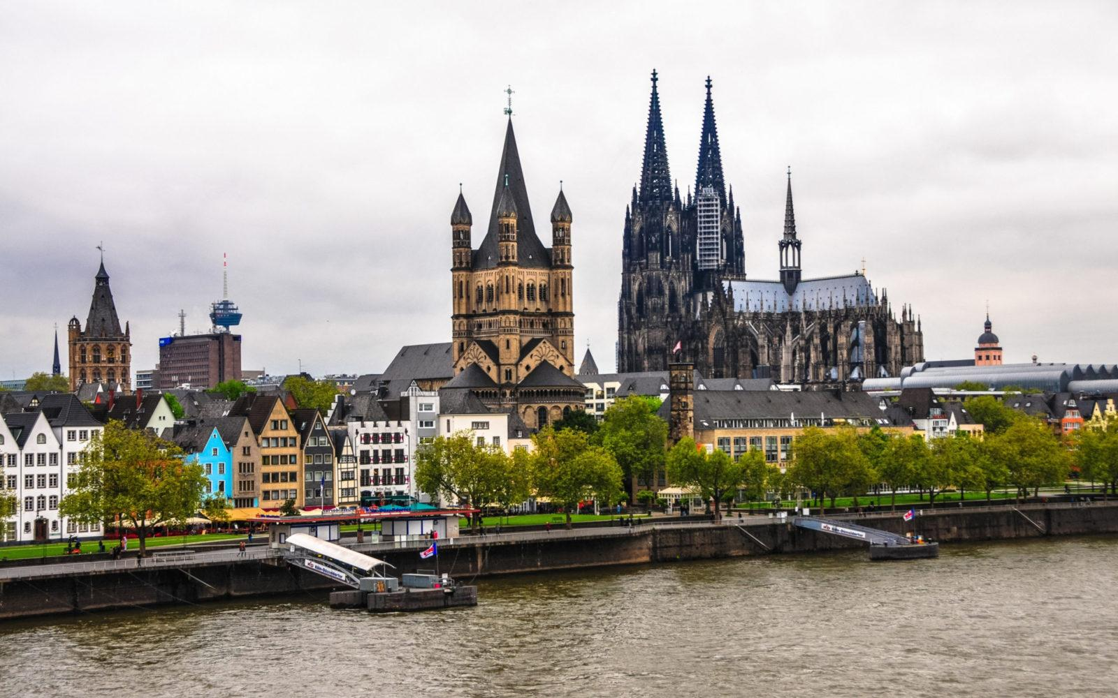 cologne cathedral river spire tourist attraction canal scaled - ავიაბილეთები კელნი